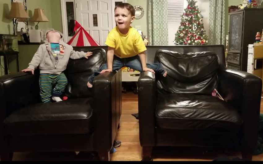 kidz playing on recliner